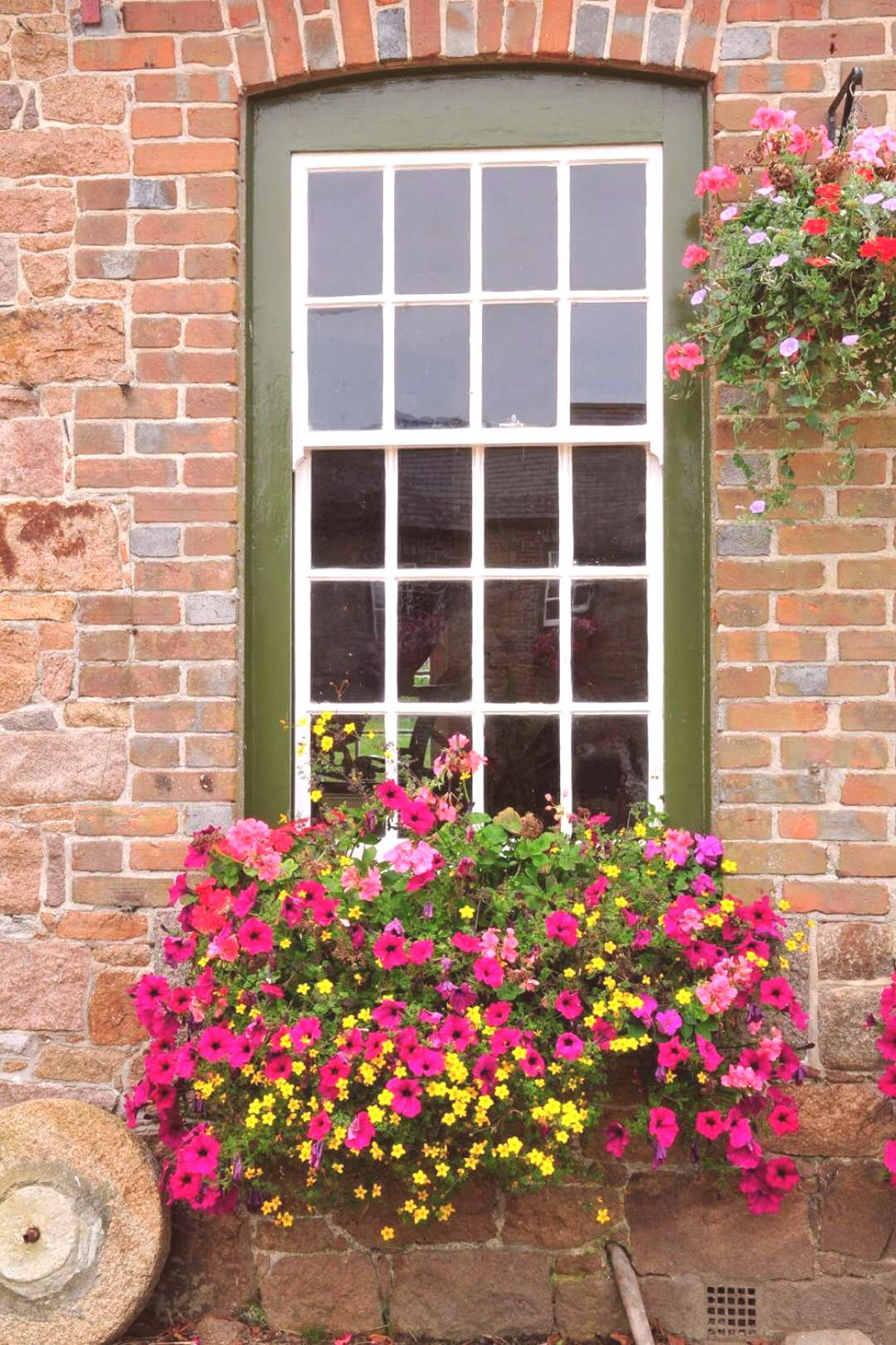 32 Stunning Flower Box Ideas & Arrangements -  A beautiful window box filled with small yellow flow