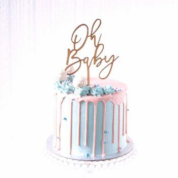 Baby Shower Drip Cake A stunning gender reveal drip cake, complete with contrasting baby blues and