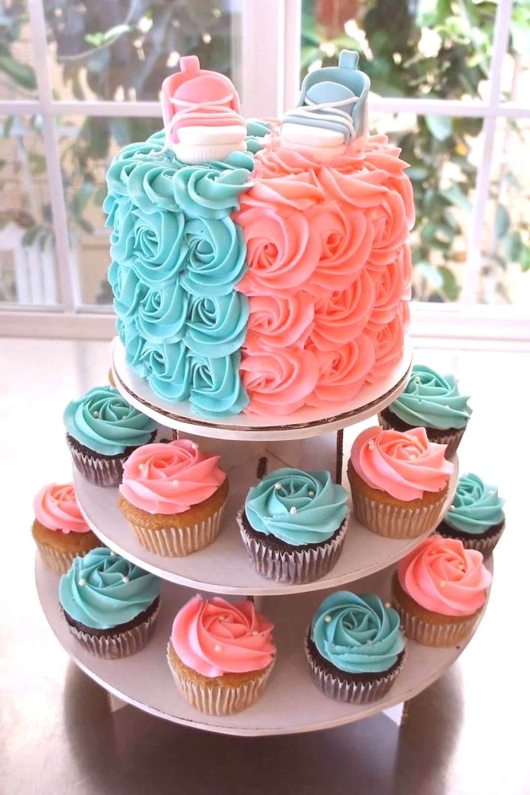 cake and cupcakes, with blue and pink frosting, gender reveal ideas, pink and blue sneakers, cake t