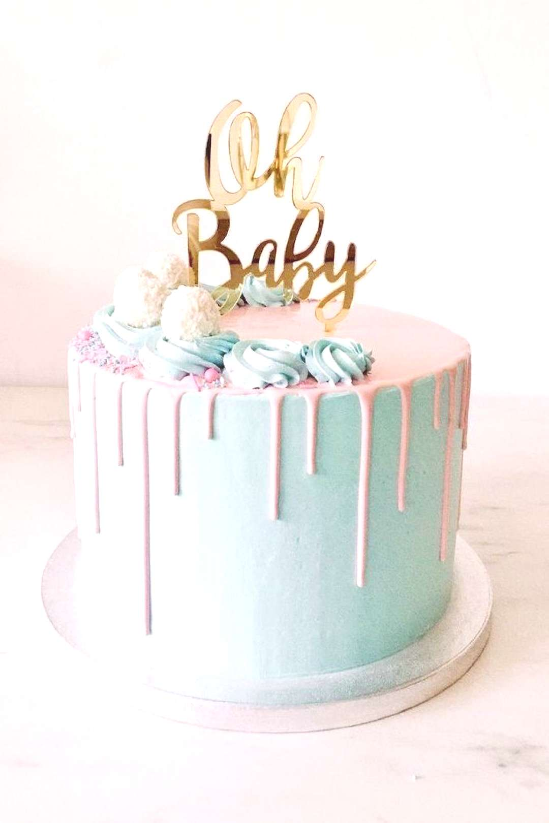 gender reveal themes, oh baby, cake topper, blue and pink frosting, silver tray